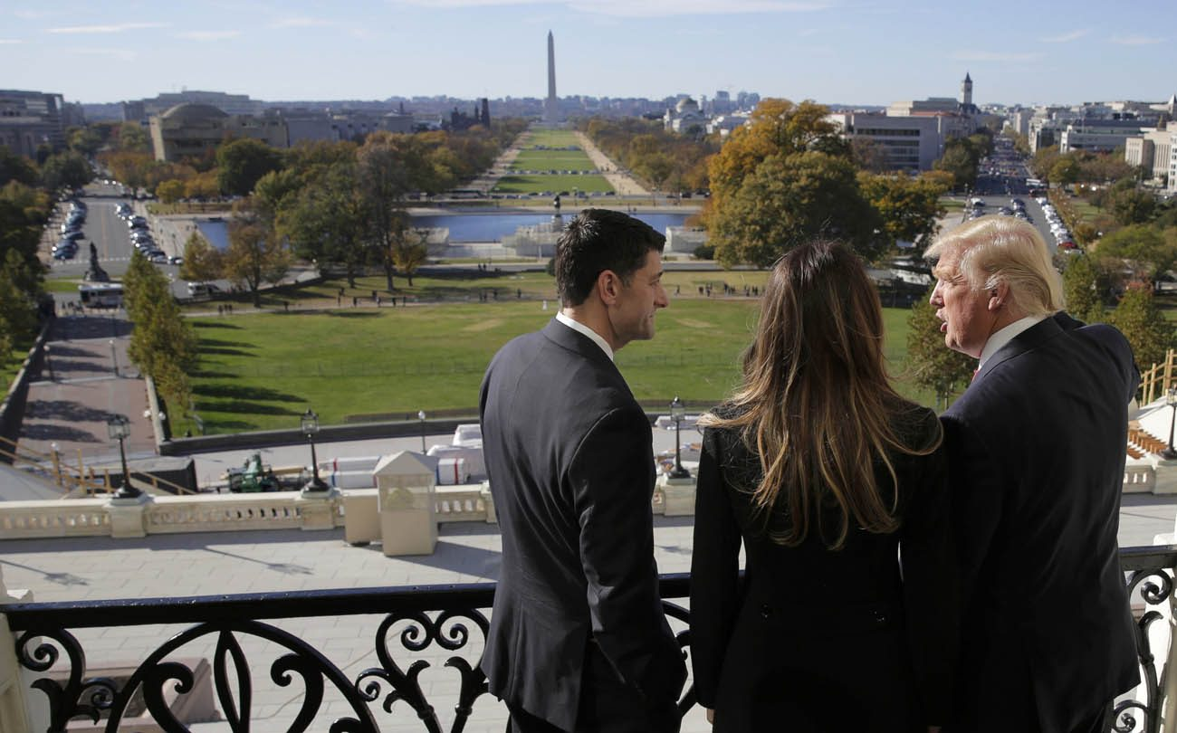 U.S. House Speaker Paul Ryan, R-Wis., shows Melania Trump and U.S. President-elect Donald Trump the Mall from his balcony on Capitol Hill in Washington Nov. 10. (CNS photo/Joshua Roberts, Reuters)