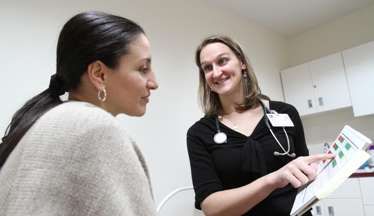 Dr. Anne Nolte, right, a family physician with the National Gianna Center for Women's Health and Fertility in New York, is pictured with a patient in 2009. A pair of Catholic physicians argue that changes in the way health care is paid for and stronger relationships between doctors and their patients will do more to improve people's health and uphold the sanctity of life than bureaucratic government-run programs and expensive insurance policies. (CNS photo/Gregory A. Shemitz)