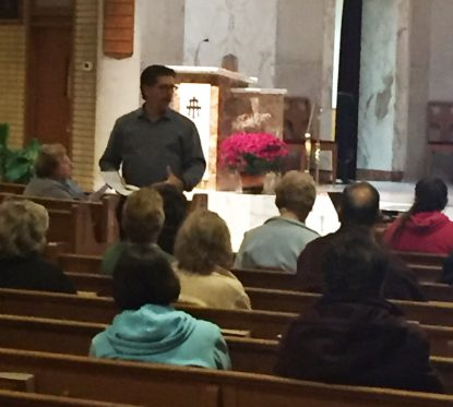 Dennis Mueller, a husband and father as well as director of religious education at St. Albert the Great Parish in Huntingdon Valley, talks with parishioners and guests at St. Pius X Church in Broomall.