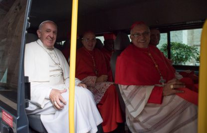 Pope Francis and new cardinals ride a bus to visit with Pope Emeritus Benedict XVI at the retired pope's residence after a consistory at the Vatican Nov. 19. (CNS photo/L'Osservatore Romano, handout)