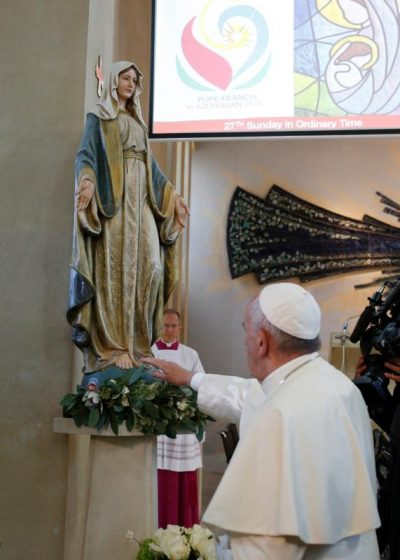 Pope Francis touches a statue of Mary as he arrives to celebrate Mass at the Church of the Immaculate Conception in Baku, Azerbaijan, Oct. 2. Mary's profound humility might seem foreign to us today. (CNS photo/Paul Haring)