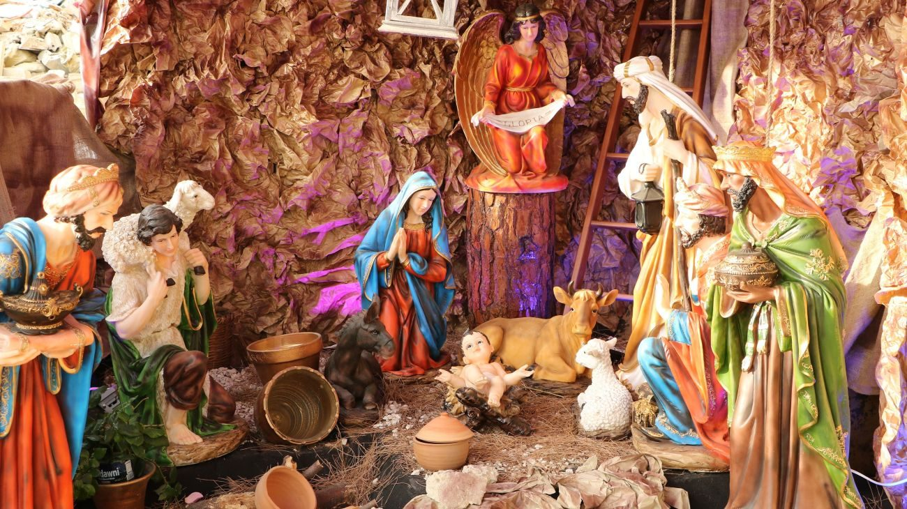 """This outdoor manger, pictured Dec. 12 at St. Talka Maronite Catholic Church in Beirut, is steps away from a busy intersection. The """"reason for the season"""" is evident in Lebanon, with the manger, or creche, even sometimes included among glistening Christmas decorations throughout the country. (CNS photo/Johnny Antoun)"""