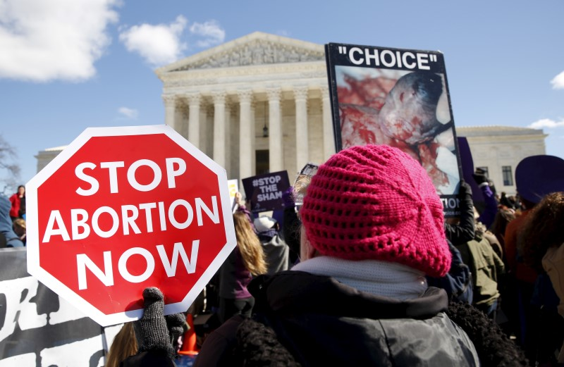Pro-life supporters demonstrate in front of the U.S. Supreme Court in early March in Washington. Pro-life leaders say they are invigorated by President-elect Donald Trump's commitments to nominate pro-life justices to the Supreme Court and support legislative efforts to limit abortion. (CNS photo/Kevin Lamarque, Reuters)