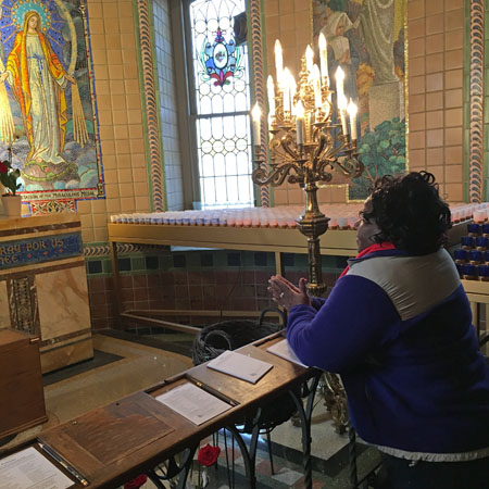 Terry Epps of St. Athanasius Parish in West Oak Lane prays in thanksgiving for favors received after she prayed a novena during a particularly hard time.