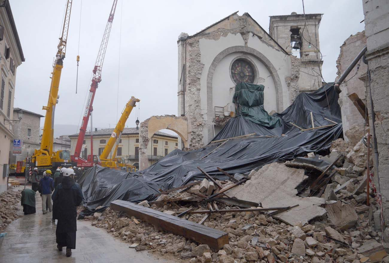 Monks from the Monastery of St. Benedict in Norcia, Italy, visit the site of their collapsed basilica, which was destroyed during the  magnitude 6.5 earthquake that struck the town Oct. 30. (CNS Photo/Courtesy the Monks of Norcia)