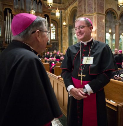 Bishop John O. Barres of Allentown, Pa., right, and another prelate, chat during a 2015 visit to the Cathedral of St. Matthew the Apostle in Washington. Pope Francis Dec. 9 accepted the resignation of Bishop William F. Murphy of Rockville Centre, N.Y., and appointed Bishop Barres as his successor. (CNS photo/Lisa Johnston, St. Louis Review)