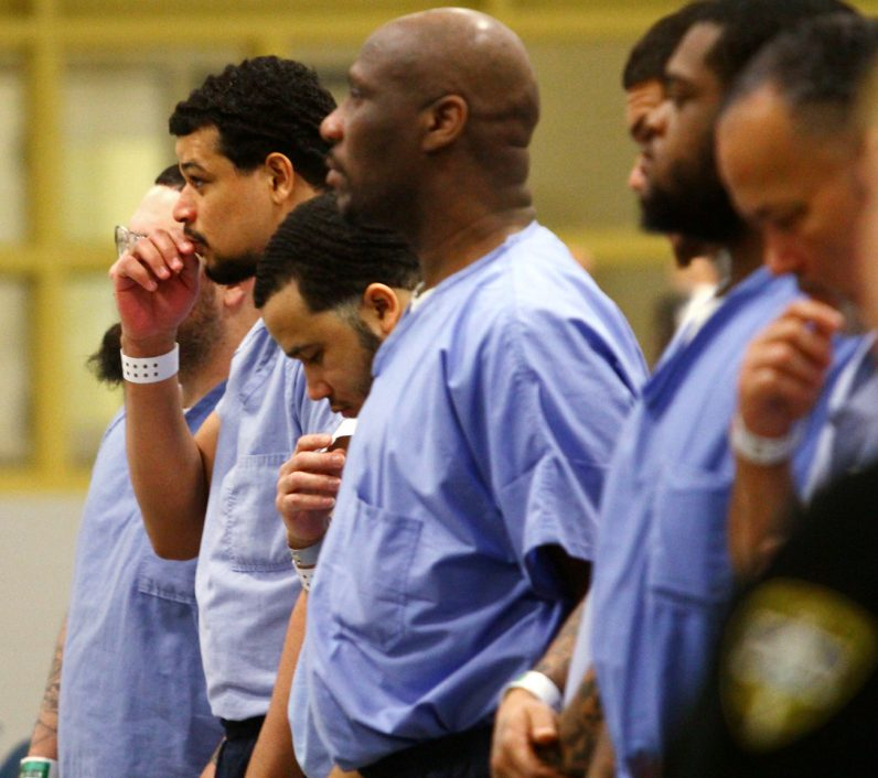 Men pray during a Mass celebrated Dec. 15 by Archbishop Charles Chaput during his visit to Curran-Fromhold Correctional Facility in Philadelphia. (Sarah Webb)