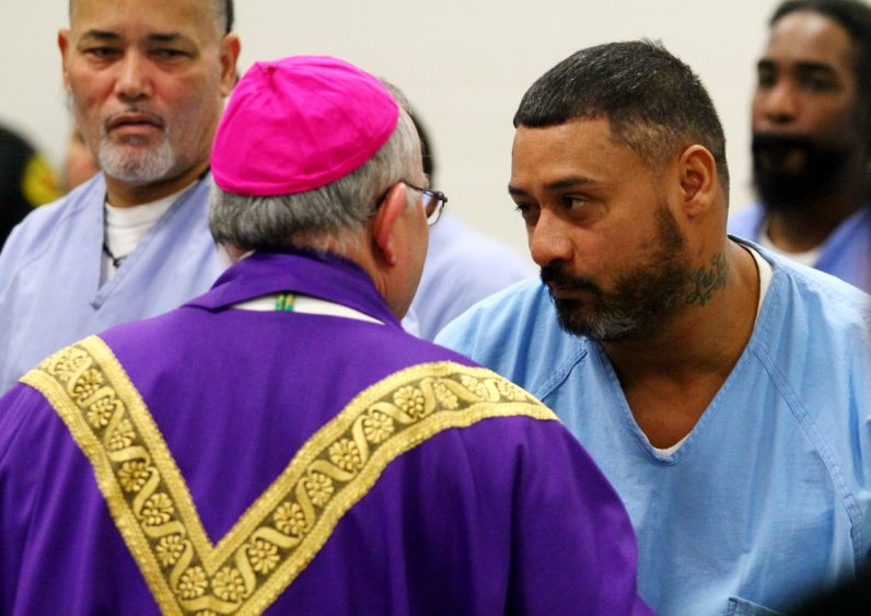 Prisoners chat with Archbishop Chaput during his Dec. 15 visit to Curran-Fromhold. (Sarah Webb)
