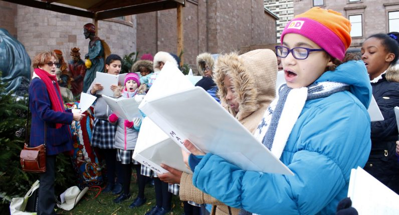 Lidya Roach and fellow students from St. Francis Xavier Elementary School perform Christmas carols at the blessing ceremony.
