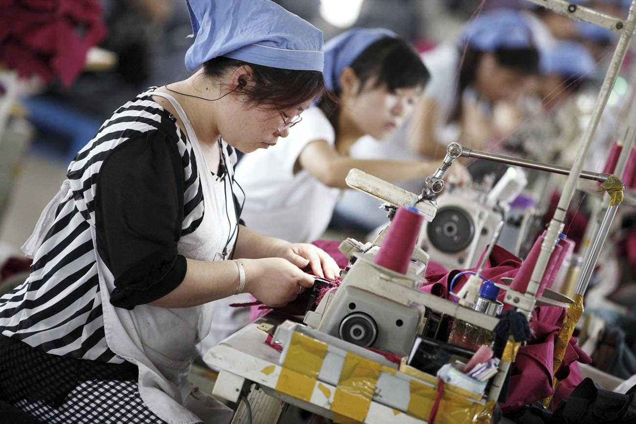 Workers make clothes to be exported at a clothing factory in Huaibei, China, June 1, 2015. (CNS photo/Stringer, EPA)