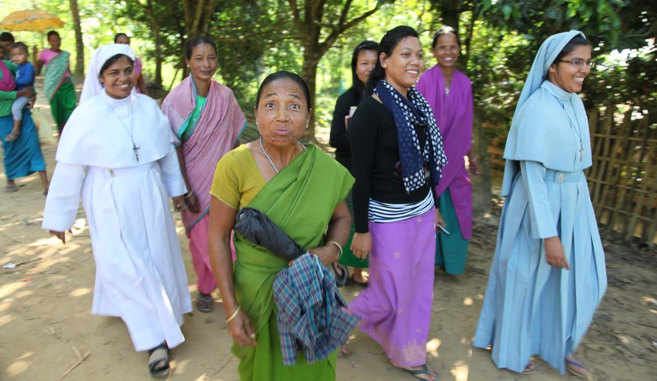 Sisters and tribal women walk in a small village in northeast India in late November. Members of two Eastern Catholic churches are taking people on a journey of faith simply by living with them. (CNS photo/John E. Kozar, CNEWA)