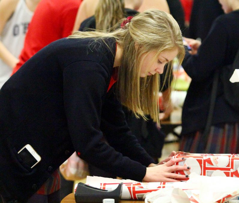 Sophmore Sara Biunno was one of nearly 400 students wrapping presents at Cardinal O'Hara High School in Springfield, Delaware County.