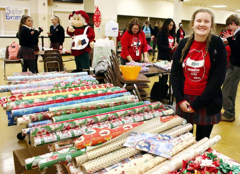 Bridget O'Shea oversees the large amount of wrapping paper needed to wrap the gifts bought by Cardinal O'Hara students.