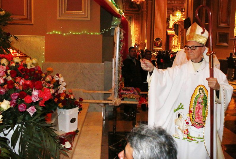 Bishop Edward Deliman blesses roses placed before the Shrine of Our Lady of Guadalupe at the Cathedral Basilica of SS. Peter and Paul.