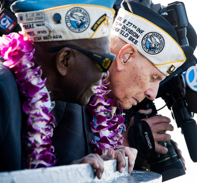 Pearl Harbor survivors Clark Simmons of Brooklyn, N.Y., and Aaron Chabin of Bayside, N.Y., look at the water after throwing a wreath into the Hudson River during a 2015 ceremony at the Intrepid Sea, Air and Space Museum in New York marking the 74th anniversary of the Japanese attack on Pearl Harbor. Dec. 7 will mark the 75th anniversary of the attack. (CNS photo/Justin Lane, EPA)