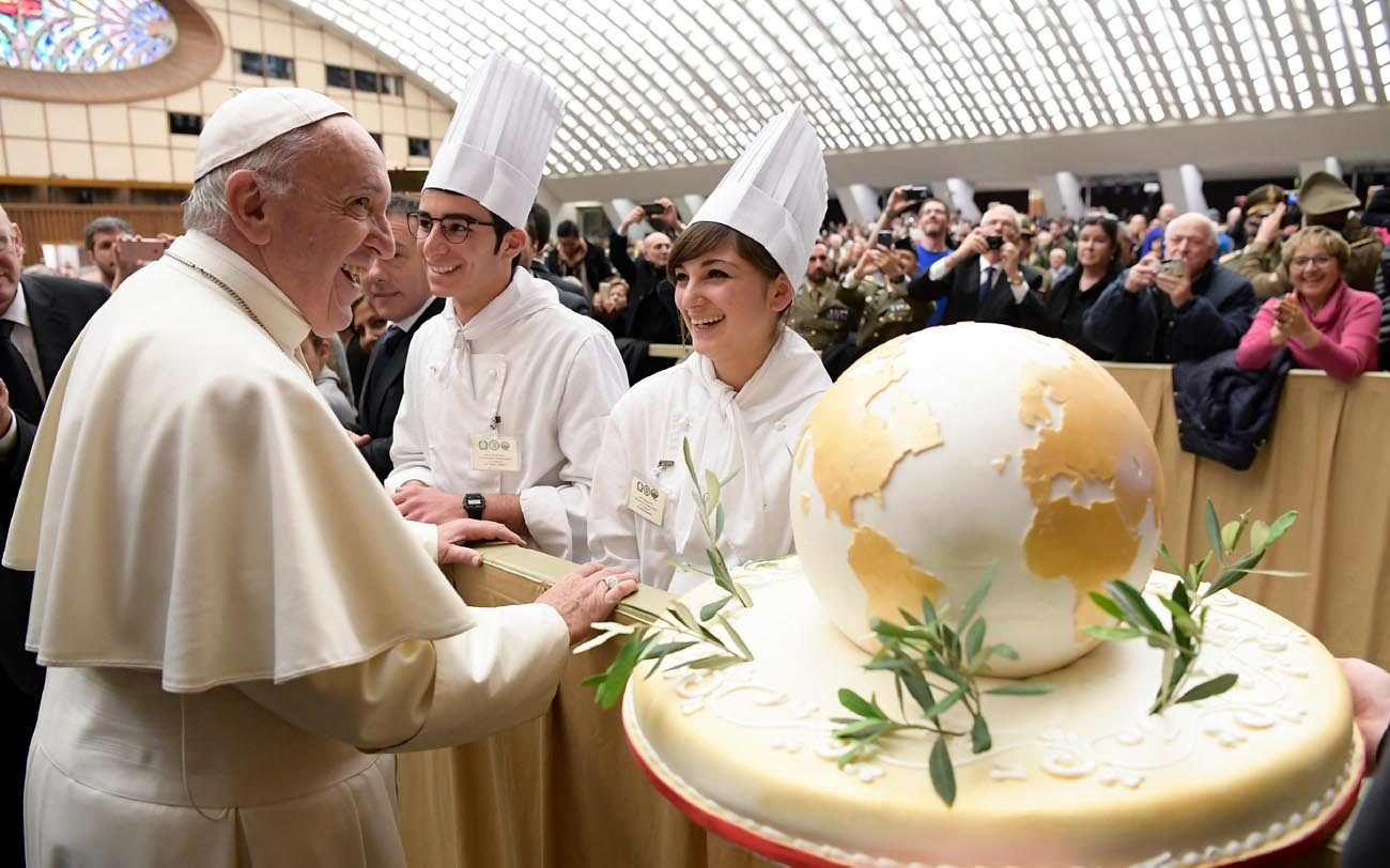 Pope Francis accepts a birthday cake from chefs during his general audience in Paul VI hall at the Vatican Dec. 14. The pope will turn 80 Dec. 17. (CNS photo/L'Osservatore Romano, handout)