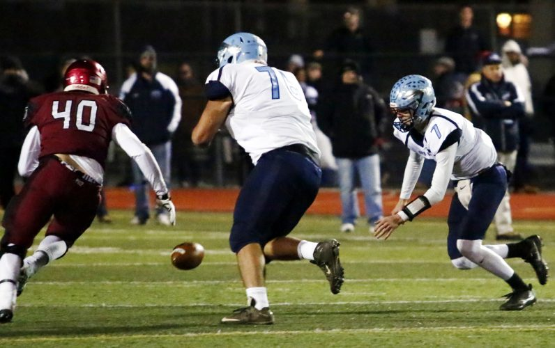North Penn quarterback Reece Udinski fumbles the ball but recovers to avert a fumble.