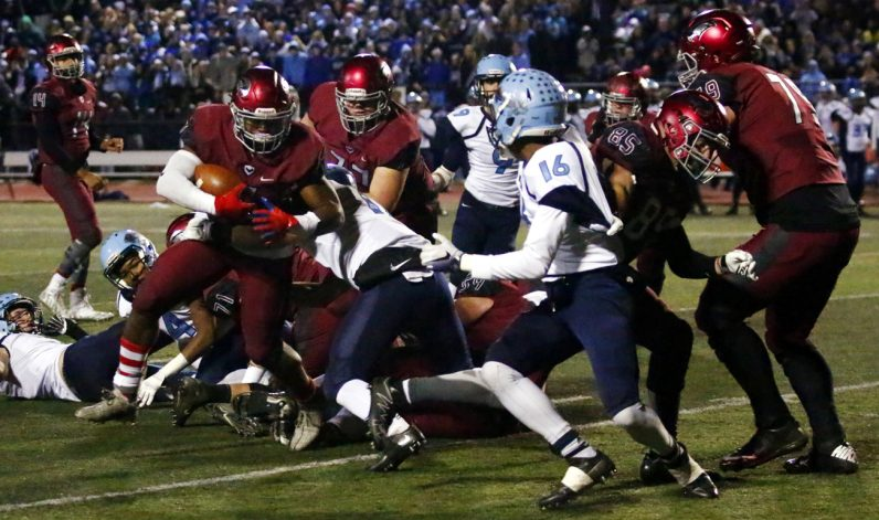 Prep's D'Andre Swift breaks a tackle by North Penn's Dan Drop.