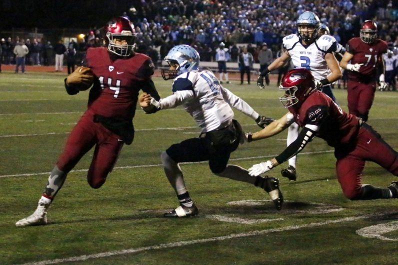Junior quarterback Marquez McCray gains yardage for St. Joseph's Prep, which won the state semifinal game against North Penn High School.
