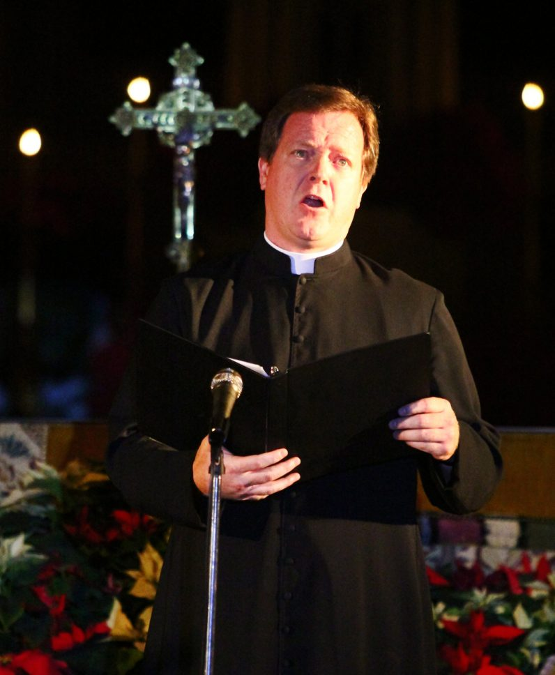 "Father Keith Chylinsky, a member of the seminary faculty, sings ""Gesu Bambino."""