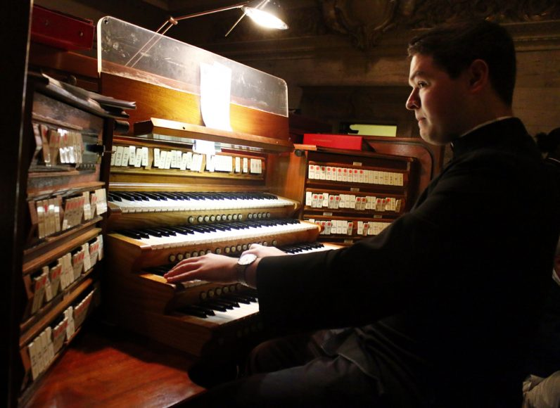 Rev. Mr. Matthew Brody plays the organ during the St. Charles Seminary Christmas Concert.