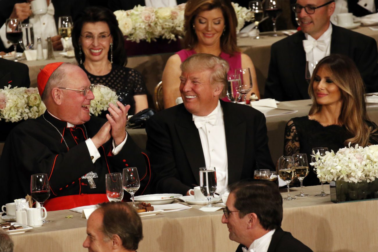 Donald Trump, then the Republicans' nominee for U.S. president, smiles as he sits between New York Cardinal Timothy M. Dolan and wife Melania during the 71st annual Alfred E. Smith Memorial Foundation Dinner in New York City Oct. 20. Cardinal Dolan is among religious leaders will read from Scripture at Trump's presidential inauguration Jan. 20. (CNS photo/Gregory A. Shemitz)