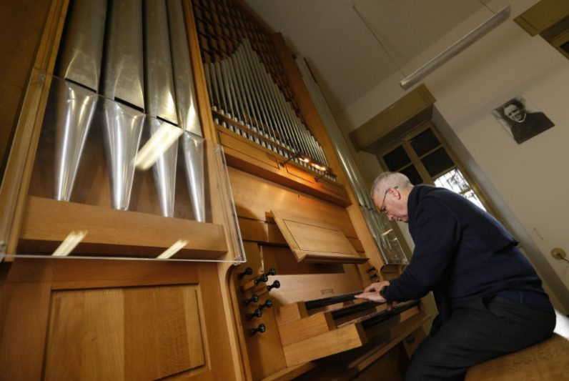 Msgr. Vincenzo De Gregorio, director of the Pontifical Institute of Sacred Music, is pictured at an organ at the institute in Rome Dec. 6. Msgr. De Gregorio said the Catholic Church tries to make music accessible to the congregation so everyone can participate. (CNS photo/Paul Haring)