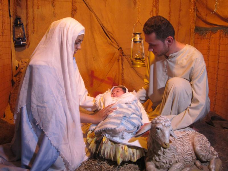 "An Iraqi man plays St. Joseph in this re-enactment of the Nativity at Ainkawa refugee camp near Irbil, Iraq, Dec. 19, 2014. Scripture tells us little about the patron saint of fathers, mainly that he was a ""righteous man"" who cared deeply for his family. (CNS photo/Sahar Mansour)"
