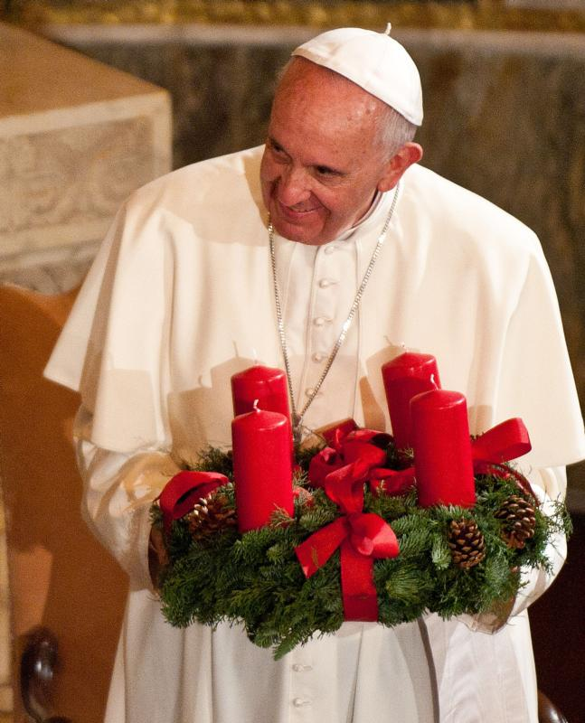 "Pope Francis is pictured with an Advent wreath in 2015. Pope Francis insisted on Gaudete Sunday 2013 that Advent joy is ""not a superficial joy."" It is the kind of joy that comes of being able to reopen our eyes, ""to overcome sadness"" and ""to strike up a new song."" (CNS photo/Massimiliano Migliorato, Catholic Press Photo)"