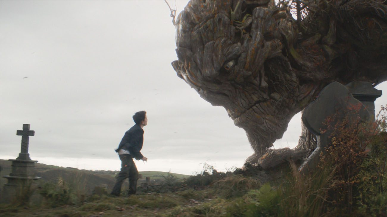 """Lewis MacDougall confronts The Monster, voiced by Liam Neeson, in the movie """"A Monster Calls.""""  (CNS photo/Focus Features)"""