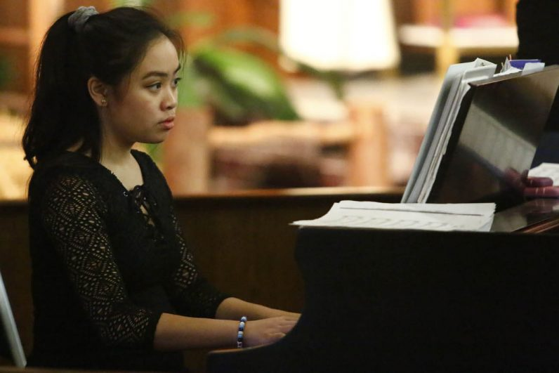 An accomplished musician and singer at the young age of 16, Angela Alquiros plays piano while her mother, Anna, serves as cantor at their parish, Epiphany of Our Lord in Plymouth Meeting. (Photo by Sarah Webb)