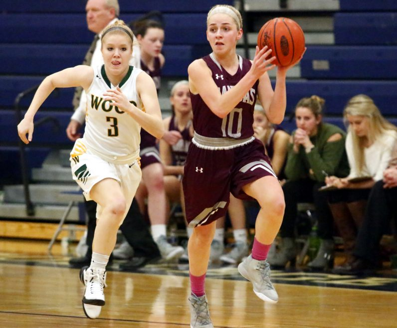 Prendie sophomore Maeve McCann makes a pass as Wood's Shannon May is on her heels.