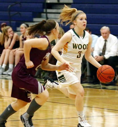 Archbishop Wood's Shannon May pushes the ball up the court. (Sarah Webb)