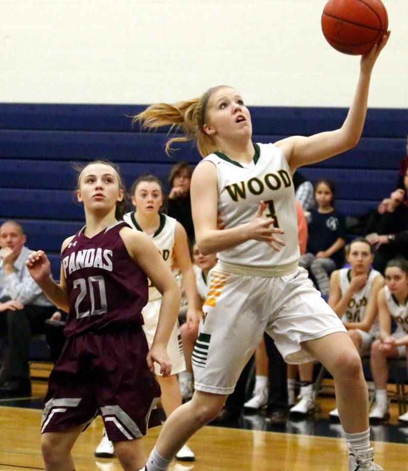 Wood's Shannon May soars for a basket.