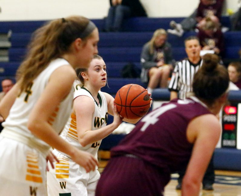 Ryleigh Parsons makes a free throw for Wood after being fouled.