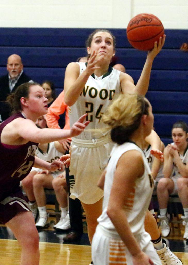Wood's Katie May slices through the defense for a layup.