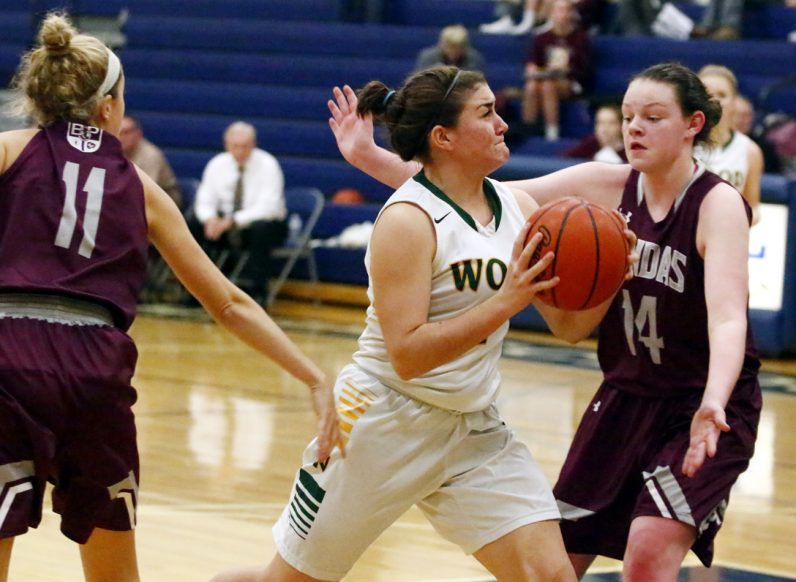 Karly Brown of Archbishop Wood pushes through the Prendie defense to get to the basket.