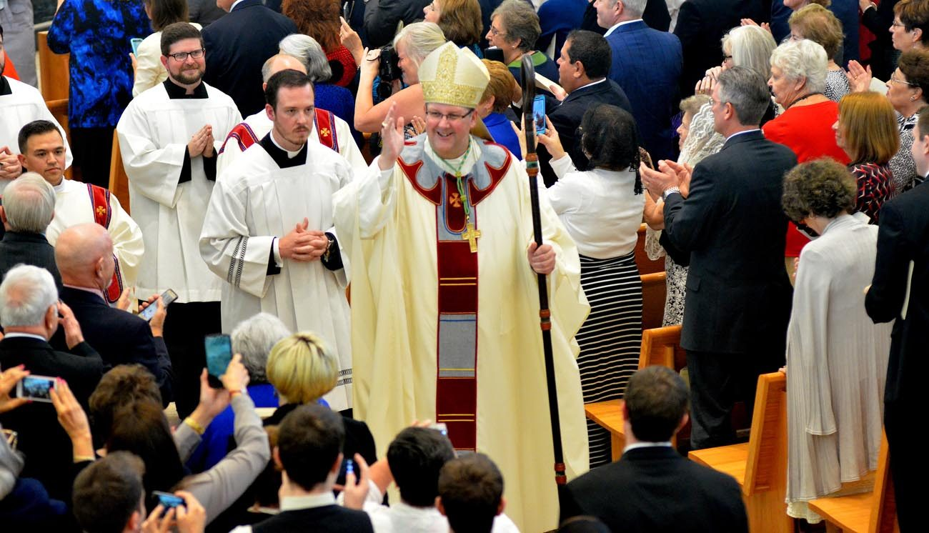 Bishop Gregory L. Parkes blesses the congregation during his Jan. 4 installation Mass as the fifth bishop of St. Petersburg, Fla., at the Cathedral of St. Jude the Apostle. (CNS photo/Maria Mertens, courtesy Diocese of St. Petersburg)