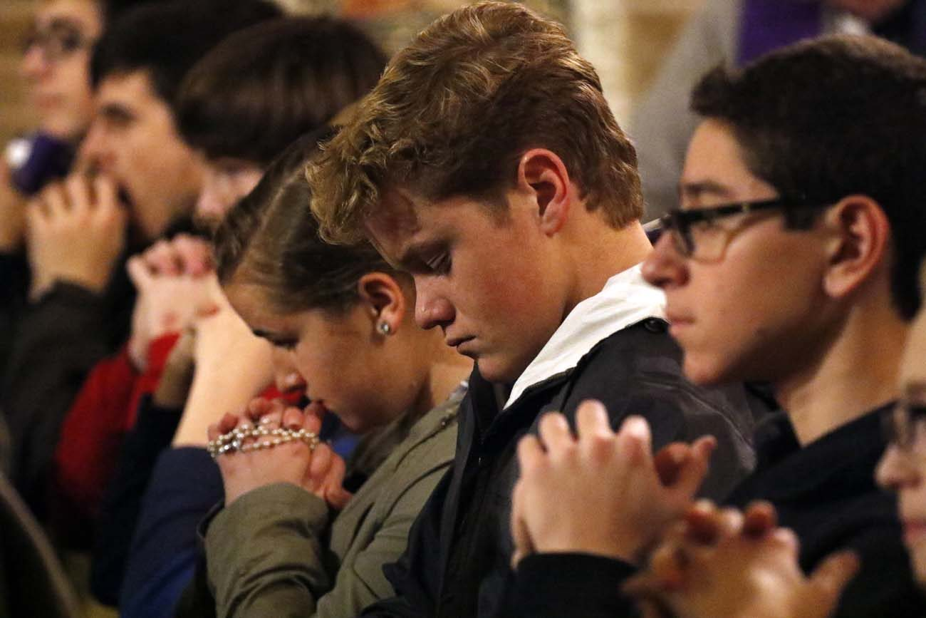 Young women and men pray during a Holy Hour for vocations Jan. 20 at St. Patrick Church in Bay Shore, N.Y. The service, which invited teenagers and young adults to pray for vocations to the priesthood and consecrated life, was sponsored by the vocations office of the Diocese of Rockville Centre, N.Y. (CNS photo/Gregory A. Shemitz, Long Island Catholic)