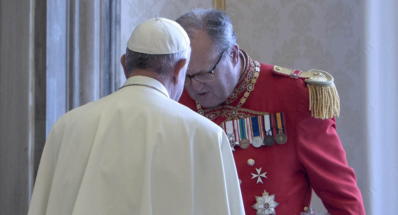 Pope Francis talks with Fra Matthew Festing, grand master of the Sovereign Military Order of Malta, during a private audience with members of the order at the Vatican in this June 23, 2016, file photo. Festing has accepted Pope Francis' request that he resign following weeks of tensions with the Vatican over the dismissal of the order's former chancellor, Albrecht Freiherr von Boeselager. (CNS photo/Maria Grazia Picciarella, pool)