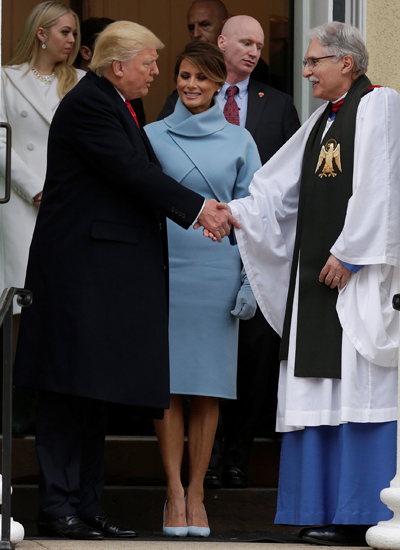 U.S. President-elect Donald Trump and his wife, Melania, greet the Rev. Luis Leon as they depart from services at St. John's Episcopal Church in Washington prior to the Donald Trump's Jan. 20 swearing-in as the country's 45th president. (CNS photo/Joshua Roberts, Reuters)