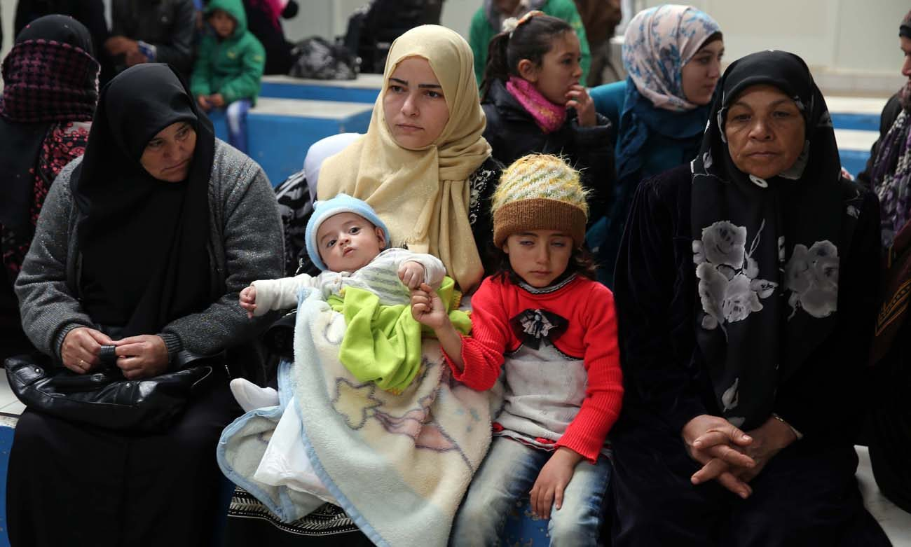 Syrian refugees wait at a clinic in 2016 at a camp near the Jordanian city of Mafraq. Promised resettlement in the United States after escaping death and destruction in their homeland, many Syrian refugees are frustrated and angry over President Donald Trump's executive action banning their entry to the U.S. until further notice. (CNS photo/Jamal Nasrallah, EPA)