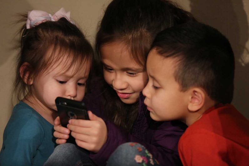 Gemma Ponce, 2, and her siblings, Isabella, 8, and Judah, 4, from Detroit, look at a video prior to the opening Mass of the National Prayer Vigil for Life at the Basilica of the National Shrine of the Immaculate Conception in Washington Jan. 26. (CNS photo/Bob Roller)
