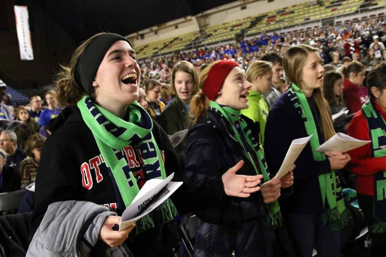 Sophomores Reagan Nemec, left, and Rachel Bell, members of the Students for Life ministry at Otterbein University in Westerville, Ohio, sing during a pro-life youth rally and Mass at the DC Armory in Washington Jan. 27 before the annual March for Life. (CNS photo/Gregory A. Shemitz)