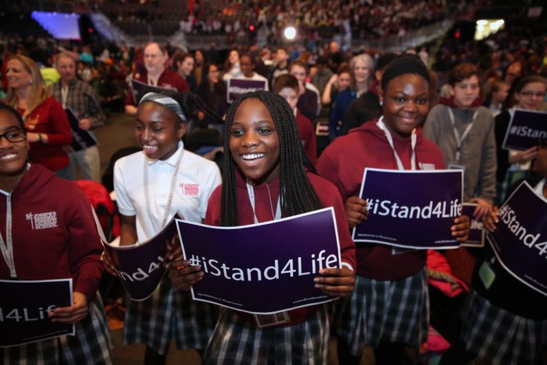 Students from St. Joseph's Regional School in Beltsville, Md. cheer during a pro-life youth rally and Mass at the Verizon Center in Washington Jan. 27 before the annual March for Life. (CNS photo/Jaclyn Lippelmann, Catholic Standard)