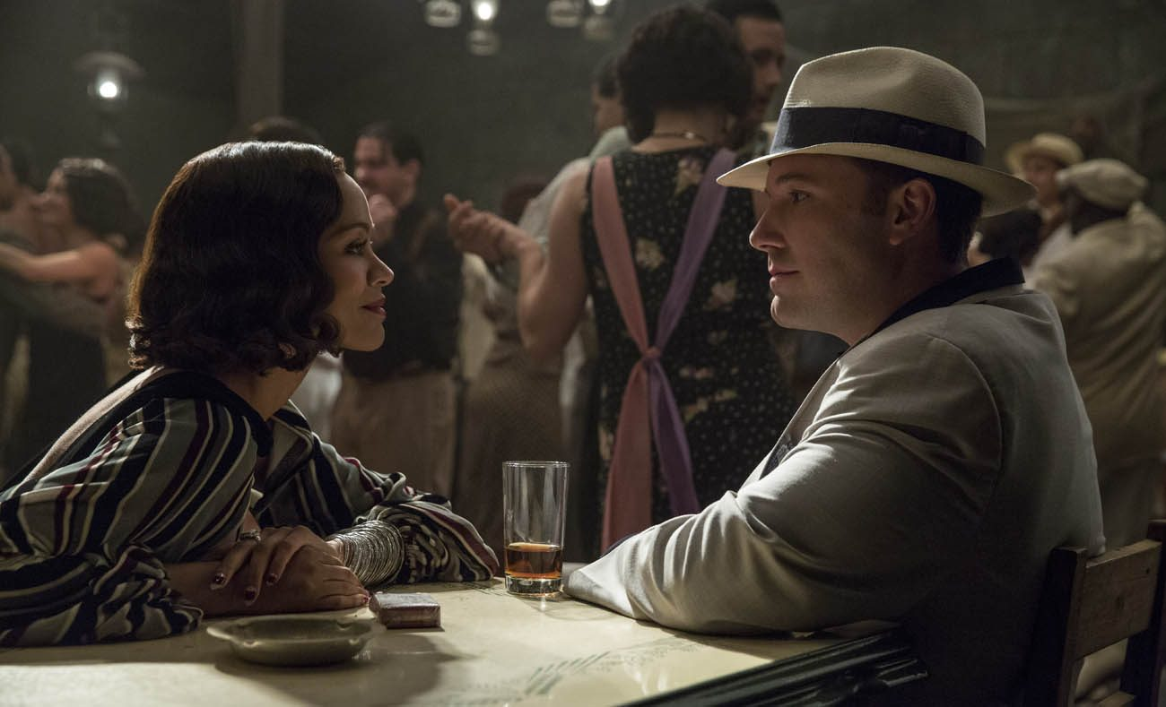 "Zoe Saldana and Ben Affleck star in a scene from the movie ""Live by Night.""(CNS photo/Warner Bros.)"