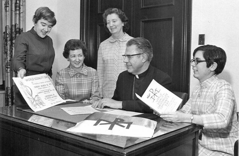 Bishop Martin N. Lohmuller reviews plans with staff for World Sodality Day in the Archdiocese of Philadelphia in February 1971.  (Photo from the Robert and Theresa Halvey Photograph Collection at the Philadelphia Archdiocesan Historical Research Center).