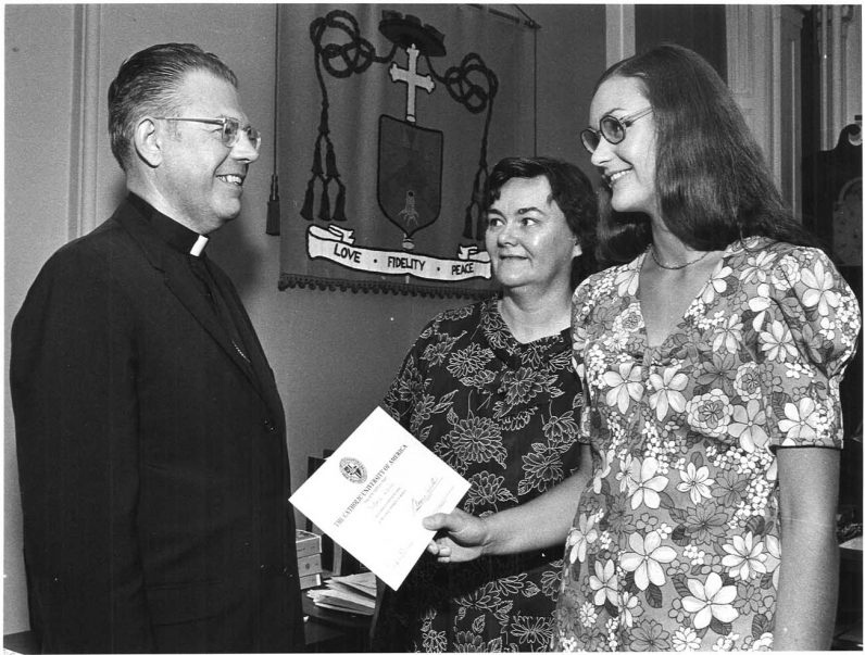 A young woman and her mother discuss with Bishop Lohmuller a scholarship award to The Catholic University of America in July 1971.  (Robert and Theresa Halvey Photograph Collection)