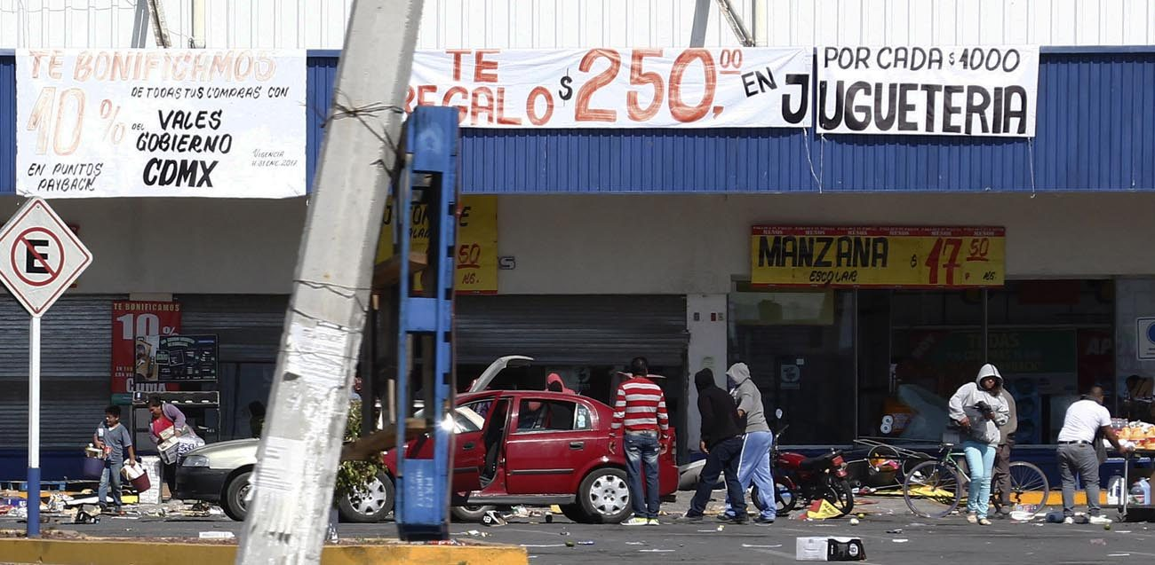People are seen looting stores in Actopan, Mexico, during a Jan. 4 protest against increasing gas prices. Mexican bishops are calling for calm after an increasing number of protests over high gas prices. (CNS photo/Ulises Naranjo, EPA)