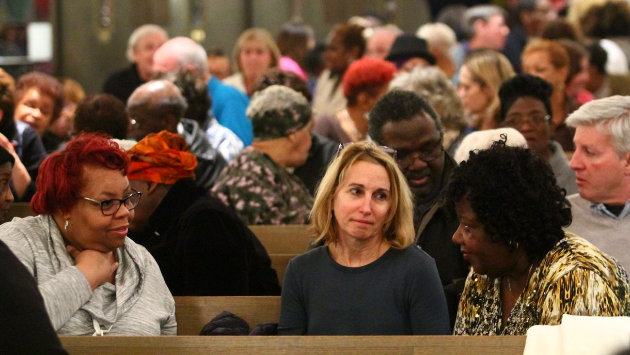 From left, Margwen Watson from St. Barbara Parish, Mary Bernhardt from St. Philip Neri Parish and Terry Epps from St. Athanasius Parish discuss race-related topics. (Photo by Sarah Webb)
